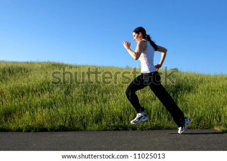 Woman sprinting on a trail - stock photo