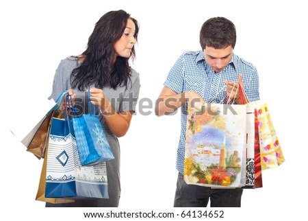 Woman spying  and being curious about a man shopping bags isolated on white background