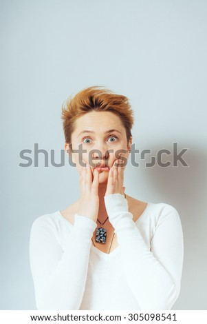 woman squeezes her cheeks - stock photo