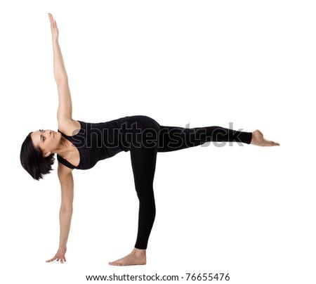 woman stand in yoga asana - half moon pose - stock photo