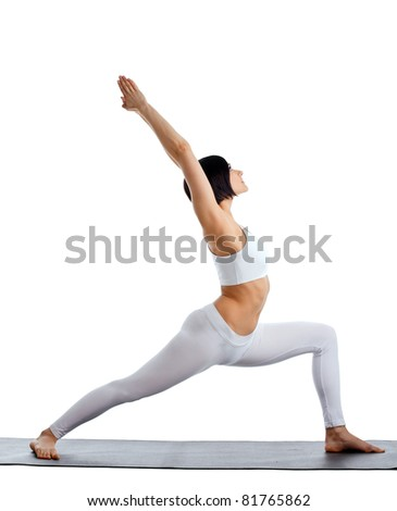 woman stand in yoga pose on rubber mat - stock photo