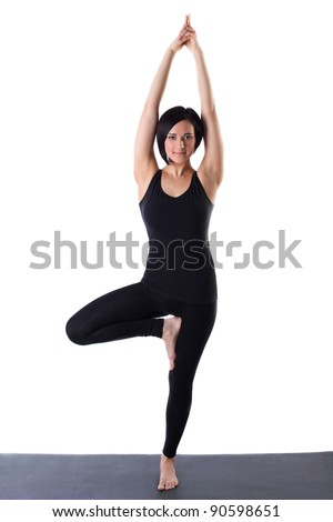 woman stand on one leg in yoga pose isolated - stock photo