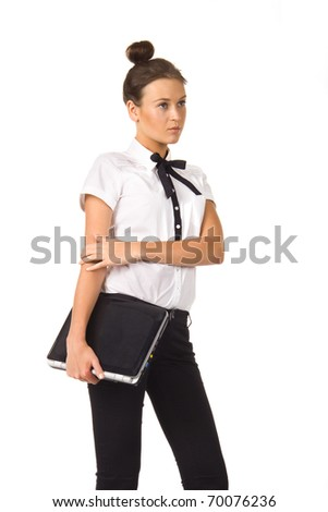 Woman standing and holding a laptop in hand on a white background, isolated picture