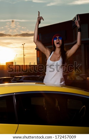 woman standing at the car