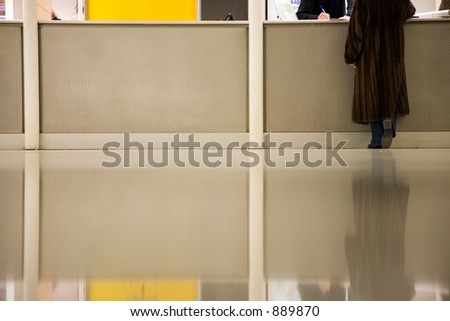 woman standing at the information counter in Parisian airport - stock photo