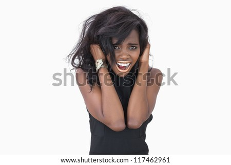 Woman standing hands in hair against white background