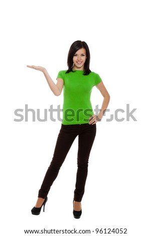 woman standing holding hand showing something on open palm with empty copy space, concept young excited girl happy smiling advertisement product, full length portrait, isolated over white background - stock photo