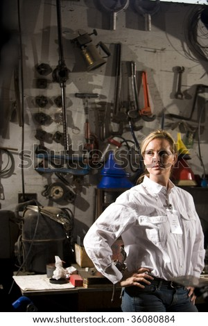 Woman standing in maintenance room - stock photo