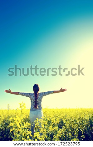 woman standing in the field - stock photo