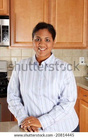 Woman standing in the kitchen of her home