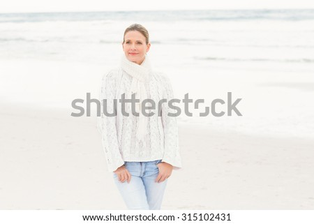 Woman standing near the shore at the beach - stock photo