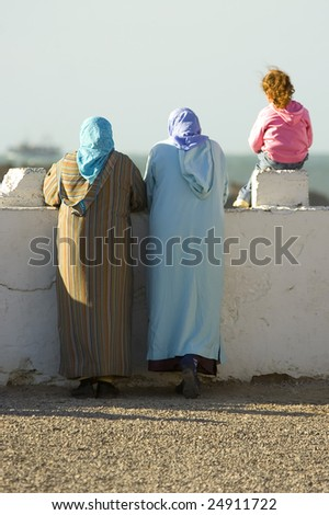 woman standing on a Essaouira port and looks into the ocean, Morocco - stock photo