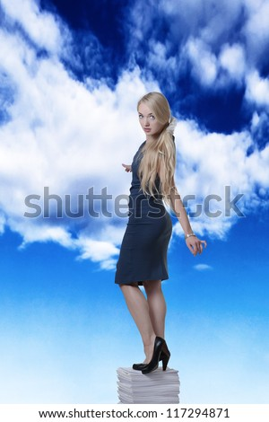 woman standing on a large pile of paper