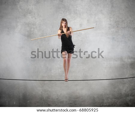 Woman standing on a rope - stock photo