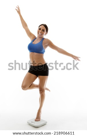 woman standing on scale looking very happy - stock photo