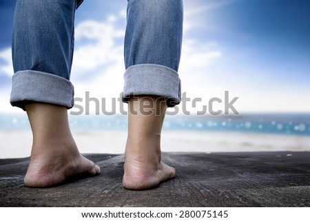 woman standing on the road and sea side background - stock photo