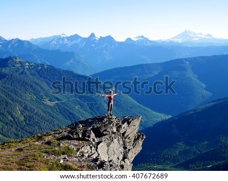 Woman Standing on Top of Mountain.  Mount Cheam summit, British Columbia, Canada.  - stock photo