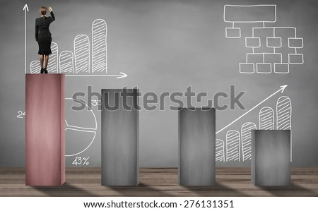 woman standing on top step and writing business project