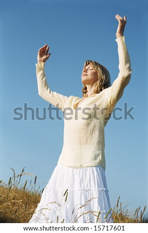 Woman standing outdoors - stock photo