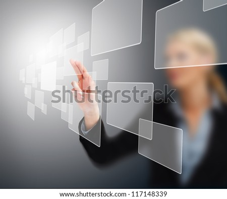 Woman standing while touching at a square touchscreen interface