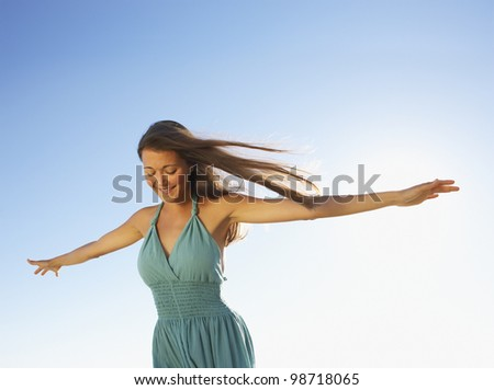 Woman standing with arms out - stock photo