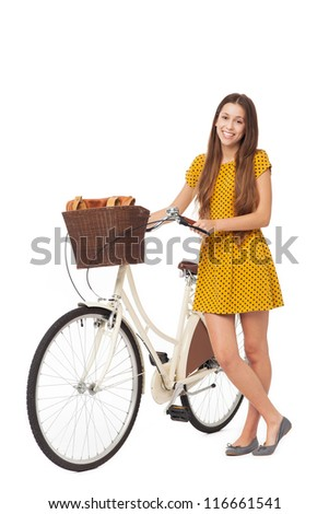 Woman standing with bike - stock photo