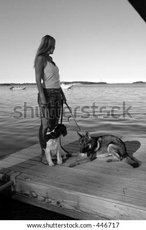 woman standing with dogs