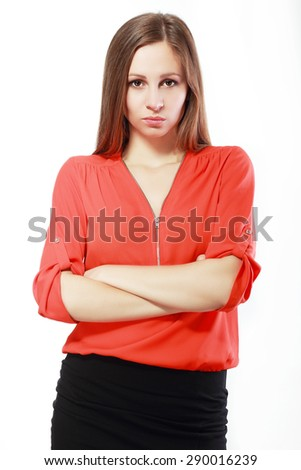 woman standing with folded arms and pursing lips - stock photo