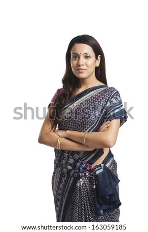 Woman standing with her arms crossed - stock photo
