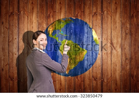 Woman stands near earth  ball texture on  wood background. Elements of this image furnished by NASA - stock photo