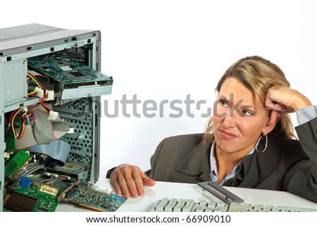 Woman stares with contempt at her broken computer - stock photo