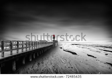 Woman staring at the sea - stock photo