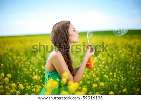 woman start soap bubbles - stock photo