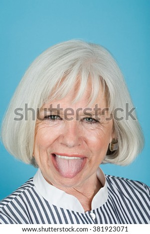 Woman sticking out tongue - stock photo