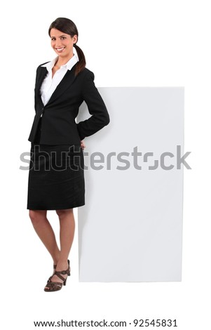 Woman stood by message board - stock photo