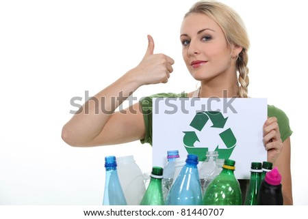 Woman stood with crate of empty plastic bottles