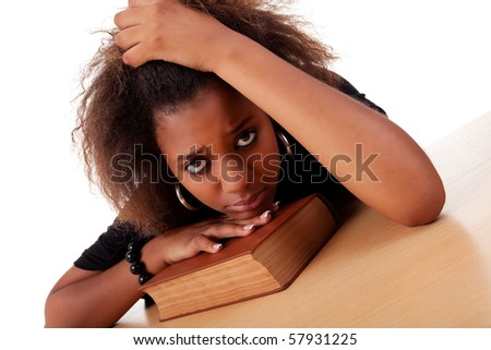 woman stressed ,with her head resting upon the book, isolated on white background. Studio shot - stock photo