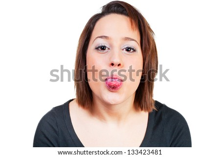 Woman stretches cheeky tongue out - stock photo