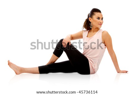 Woman stretches isolated over a white background