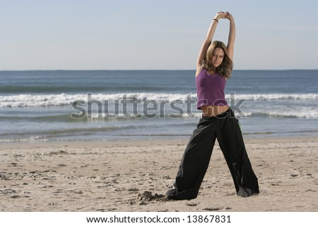 woman stretching at the beach