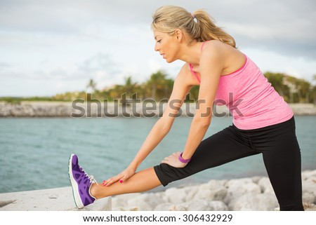 Woman stretching before morning exercise