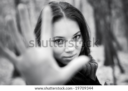 Woman stretching hand to the camera. Black and white concept. - stock photo