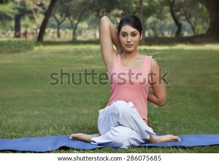 Woman stretching her arms in a yoga - stock photo