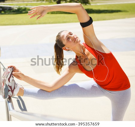 Woman stretching her leg