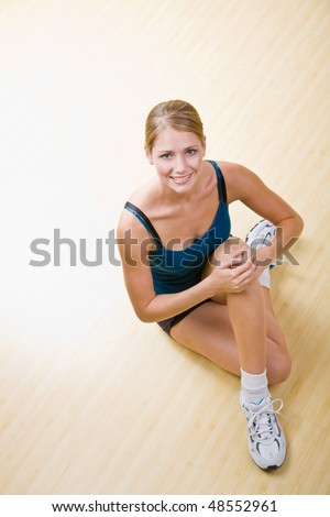 Woman stretching in health club - stock photo