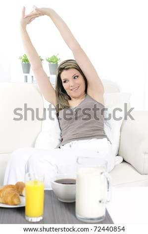 woman stretching in the morning before eating breakfast - stock photo