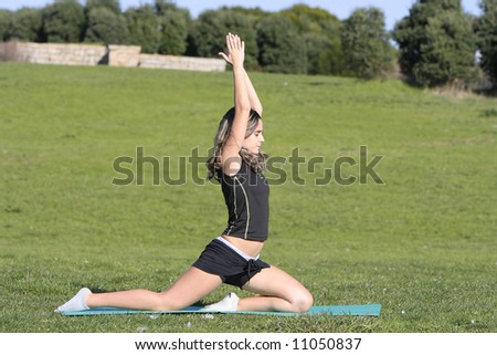 woman stretching in the park - stock photo