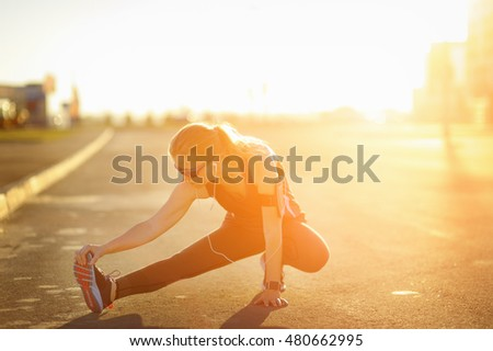Woman stretching legs before exercise. Marathon