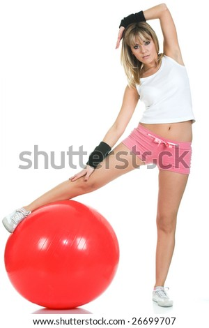 Woman stretching on fit ball. Pilates ball and fitness girl concept - stock photo