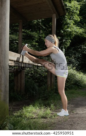 Woman stretching workout outdoor sport - stock photo